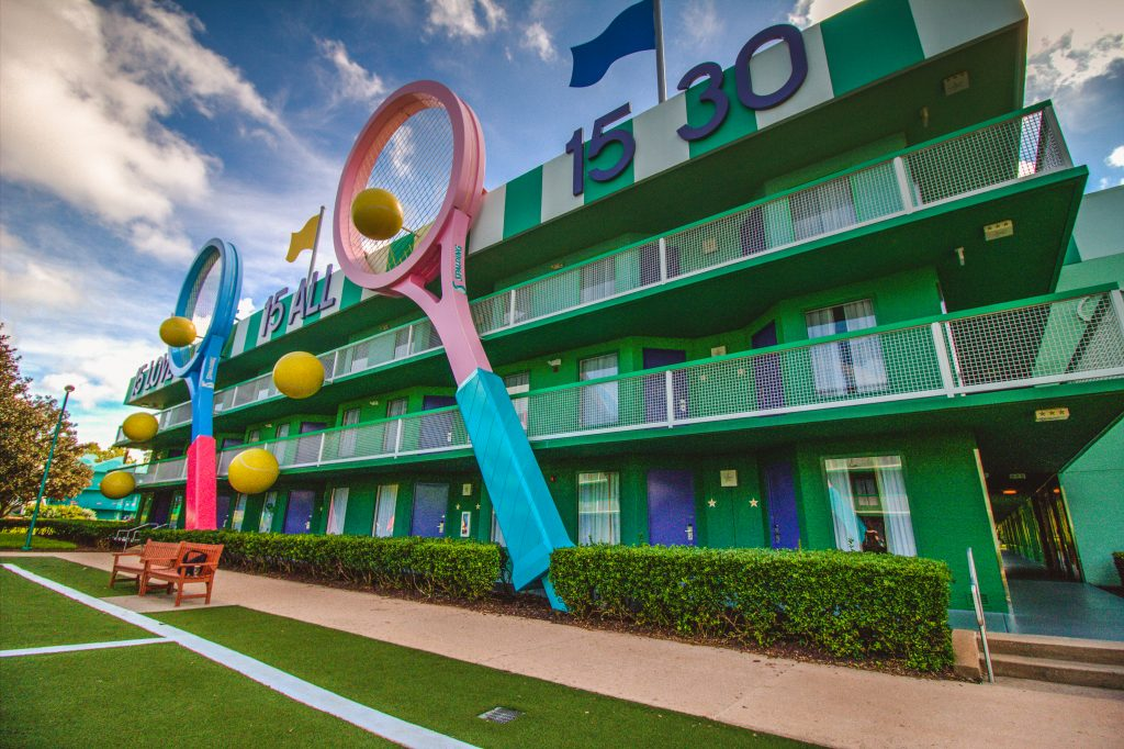 Center Court features larger than life tennis racquets and tennis balls between the two guest buildings. This is across the courtyard from Hoops Hotel