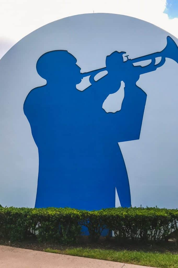 A musician playing a trumpet on the face of the drums in the Jazz Inn area of All Star Music