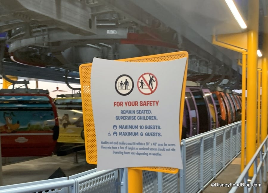 Sign Displaying Disney Skyliner Rules for Occupancy | A maximum of 10 guests can ride in a Disney Skyliner car