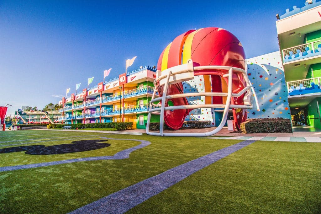3 story tall football helmets are the centerpieces of Touchdown. This area features a football field in the middle where guests can watch movies on the lawn after dark