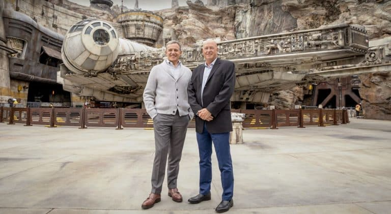 Former Walt Disney Company CEO Bob Iger poses with current CEO Bob Chapek in front of the Millennium Falcon at Galaxy's Edge