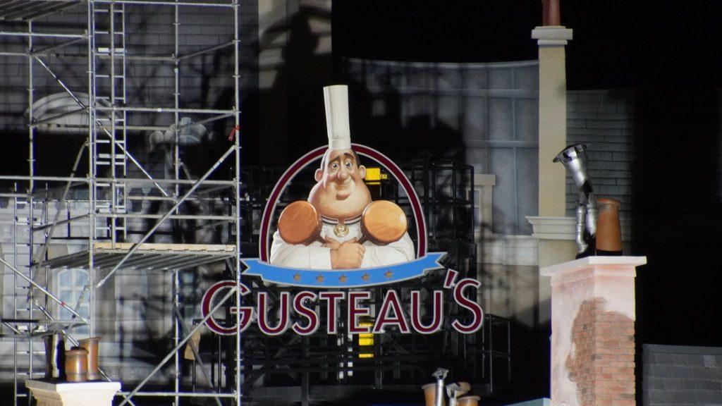 Gusteau's Restaurant signage lit up by construction lighting in the France pavilion expansion | Walt Disney World, FL