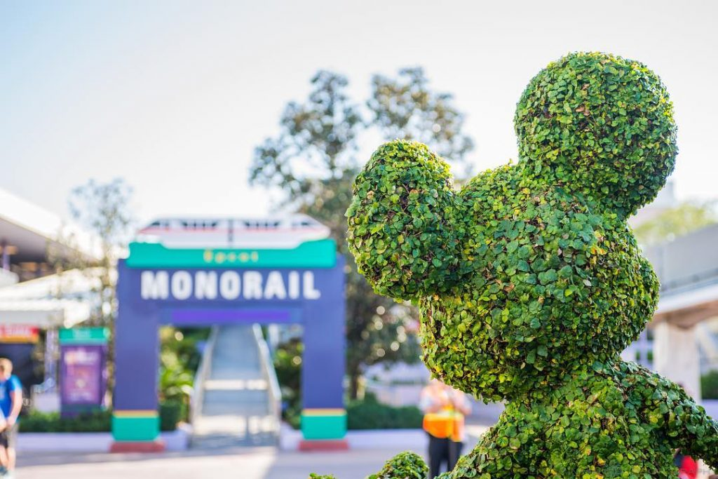 Mickey Shrub Looking at the Monorail Entrance to go to Epcot